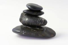Cuatro piedras negras foto de archivo
