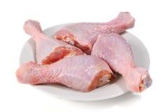 Cuatro piernas de pollo sin procesar frescas Imagen de archivo libre de regalías