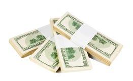 Cuatro pilas de cientos dólares de billetes de banco aislados en blanco Fotografía de archivo libre de regalías
