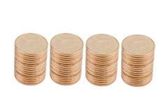Cuatro pilas de monedas de oro Fotos de archivo libres de regalías