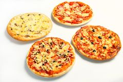 Cuatro pizzas Foto de archivo