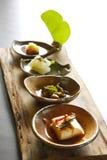 Cuatro platos de alimento vegetal Imagenes de archivo