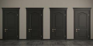 Cuatro puertas negras en la pared fotos de archivo
