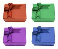 Cuatro rectángulos de regalo con los arqueamientos Fotografía de archivo