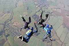 Cuatro skydivers en caída libre Fotografía de archivo libre de regalías