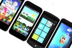 Cuatro Smart-teléfonos Foto de archivo