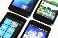 Cuatro smartphones Fotos de archivo libres de regalías