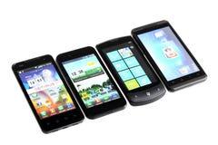 Cuatro smartphones Imágenes de archivo libres de regalías