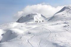 Cuatro Snowboarders Fotografía de archivo libre de regalías