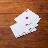 Cuatro tarjetas que juegan de los as Imagenes de archivo
