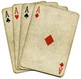 Cuatro tarjetas sucias viejas del póker de los as. Fotos de archivo libres de regalías