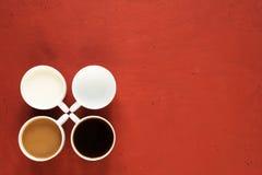 Cuatro tazas con leche y café fotos de archivo libres de regalías