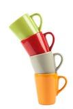 Cuatro tazas de té del color Fotografía de archivo