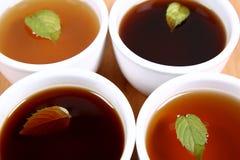 Cuatro tazones de fuente de té foto de archivo libre de regalías