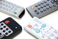 Cuatro telecontroles Imágenes de archivo libres de regalías