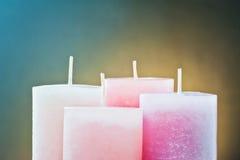 Cuatro velas de la cera para la Navidad Imagen de archivo libre de regalías