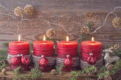 Cuatro velas de la Navidad Imágenes de archivo libres de regalías