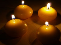 Cuatro velas de luz Imágenes de archivo libres de regalías