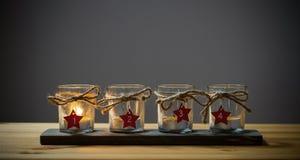 Cuatro velas del advenimiento en gris Imagen de archivo