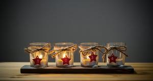 Cuatro velas del advenimiento en gris Fotografía de archivo