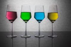 Cuatro vidrios coloreados de agua Fotografía de archivo libre de regalías