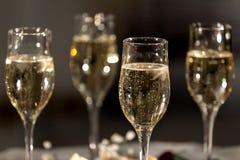 Cuatro vidrios con champán Imagenes de archivo