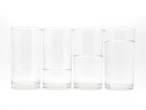Cuatro vidrios con de tres niveles del agua Imagen de archivo libre de regalías