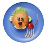 Cub hizo del pan y de las verduras en la placa azul Imagen de archivo