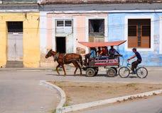 Cuba. SANCTI SPIRITUS, CUBA - FEBRUARY 6: Cubans ride horse-drawn cart on February 6, 2011 in Sancti Spiritus, Cuba. Cuba has one of lowest vehicle per capita Royalty Free Stock Photography