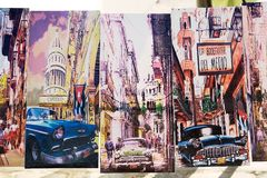 Cuba. Ol classic american car in the unknown artist paintings on sale at the daily market at the San Juan de Dios square, Camaguey, Cuba Royalty Free Stock Images
