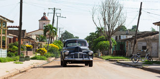 Cuba american black vintage car drives on the road Royalty Free Stock Photo