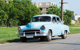 Cuba american blue Oldtimer drives on the road Royalty Free Stock Photography