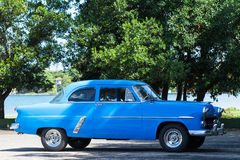 Cuba american blue Oldtimer drives on the road Royalty Free Stock Photos