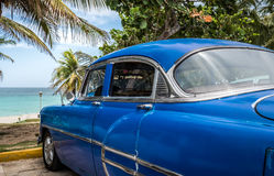 Cuba american blue Oldtimer parked near the beach Royalty Free Stock Images
