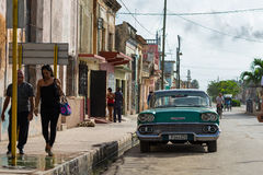Cuba american classic car parked for a building in the province Royalty Free Stock Photo