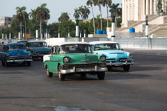 Cuba american classic cars drives on the mainstreet in Havanna for the capitol Royalty Free Stock Image