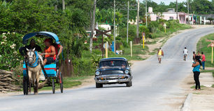 Cuba american Oldtimer drives in the countryside Stock Photos