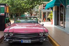 Cuba american pink Oldtimer at the gas station Royalty Free Stock Photography