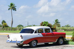 Cuba american red white Oldtimer parked on the road Stock Photo