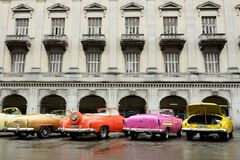 Cuba - attractive old cars are waiting for tourists stock photos