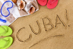 Cuba beach sand word writing. Cuba beach writing : Cuban beach background with towel and flip flops Royalty Free Stock Photography