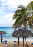Cuba beach with sunlounger in Varadero.  Royalty Free Stock Images