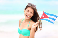 Cuba beach woman holding cuban flag. During resort vacation travel on cuba. Beautiful young mixed race Asian Caucasian happy and smiling in bikini Stock Photography