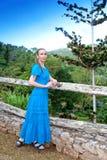 Cuba. The beautiful woman in a long blue dress in park of Soroa. (Jardin Botanico Orquideario Soroa Royalty Free Stock Image