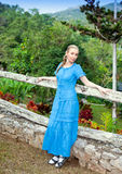 Cuba. The beautiful woman in a long blue dress in park of Soroa (Jardin Botanico Orquideario Soroa) Stock Images