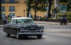 Cuba black green american Oldtimer drives in the city from Havana Royalty Free Stock Photography
