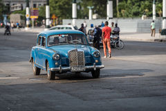 Cuba blue american Oldtimer drives on the Main street in Havana Royalty Free Stock Images