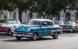 Cuba blue white american Oldtimer drives on the Main street in Havana Stock Photos