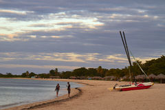 Cuba, 2014 - a boat and people in the Caribbean beach. Stock Photos