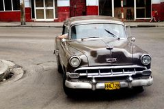 Cuba: Brown classic car driving Stock Photos